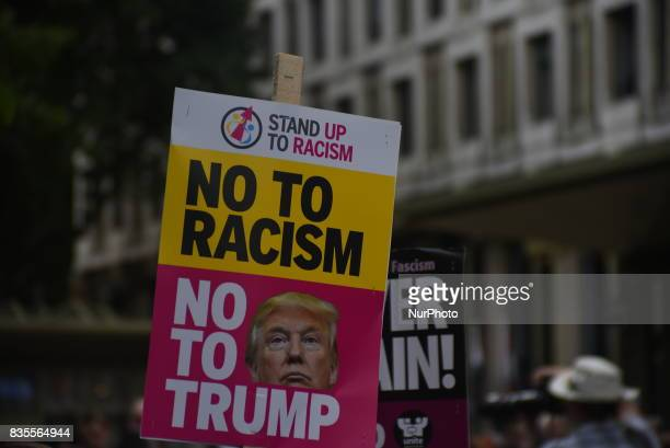 Demonstrators gathered outside the American Embassy in Central London to protest against the racism escalation following the riot in Charlottesville...