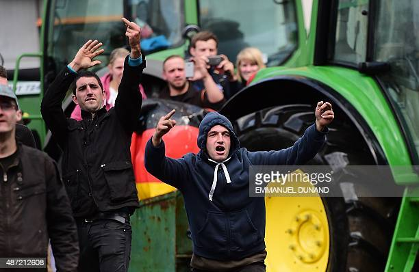 Demonstrators gesture and insult antiriot policemen during a demonstration of farmers in front of the European Commission building on September 7 in...