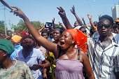 Demonstrators gesture during a protest on November 21 2014 in Lome asking for political reform to limit a president to a maximum two fiveyear terms...