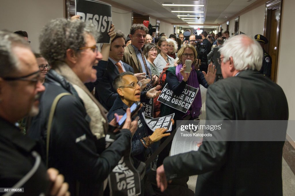Demonstrators greet Sen. Bernie Sanders (I-VT) on his way to the full committee markup of the FY2018 Reconciliation Legislation on November 28, 2017 in Washington, DC. Republicans in the Senate hope to pass their tax cut legislation this week and work with the House of Representatives to get a bill to President Donald Trump before Christmas.