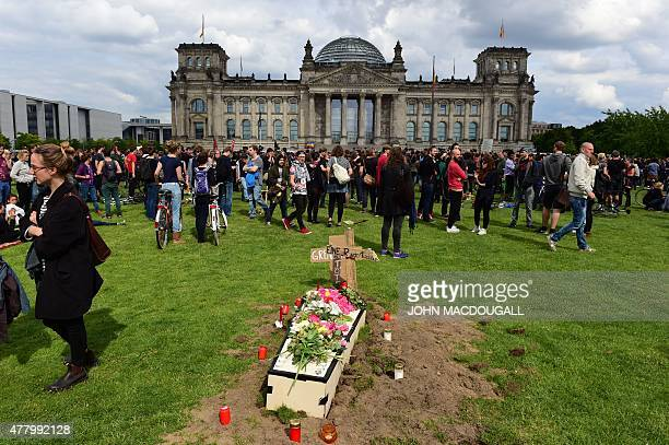 Demonstrators have installed a symbolical refugee grave in front of the Reichtsag building housing the Bundestag near the Chancellery on June 21 2015...