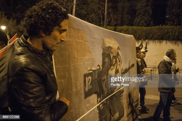SYNTAGMA ATHENS ATTIKI GREECE Demonstrators hold a banner depicting American President Donal Trump as a Isaelli Tank Greek activists and Palestinians...