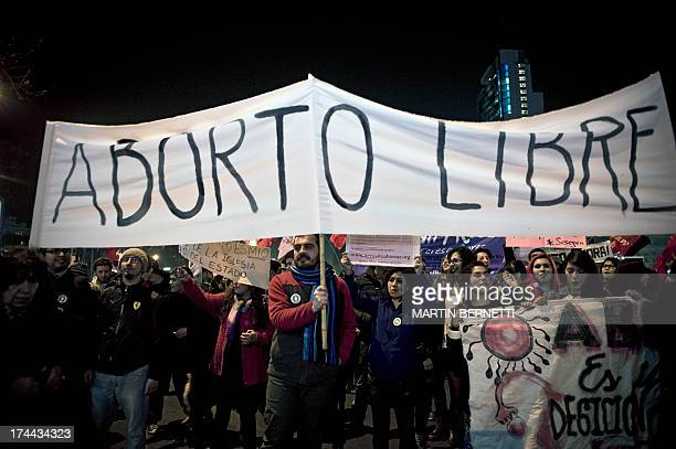 Demonstrators hold a banner reading 'Free Abortion' during a march for the legalization of abortion in Santiago on July 25 2013 AFP PHOTO/MARTIN...