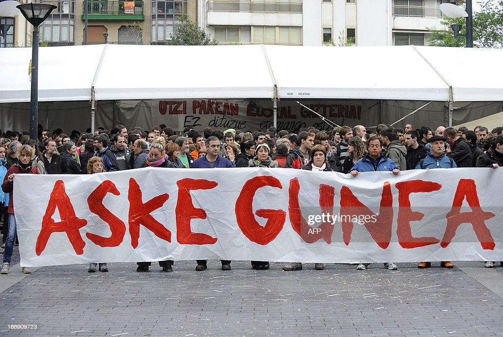 Demonstrators hold a giant banner reading in Basque 'Free Zone' during a protest against the incarceration of eight members of Basque pro-independence youth organization SEGI in the northern Spanish Basque city of San Sebastian on April 18, 2013. Hundreds of people remain gathered in San Sebastian, to prevent the incarceration of eight members of SEGI sentenced to six years in prison by the Supreme Court. The Spanish Court issued arrest warrants on April 16 against Mikel Arretxe, Imanol Vicente, Naikari Otaegi, Egoi Alberdi, Aitor Olaizola, Adur Fernandez, Oier Lorente y Ekaitz Ezkerra for membership in an organized armed group. AFP PHOTO / ANDER GILLENEA
