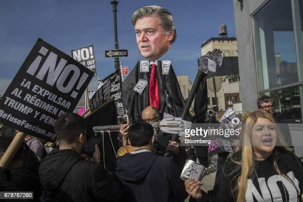 A demonstrators hold a photo of Steve Bannon chief strategist for US President Donald Trump while protesting across from the Intrepid Sea Air Space...