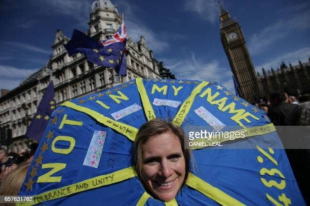 A demonstrators hold a placard depicting as she passes the Houses of Parliament during an anti Brexit proEuropean Union march in Westminster central...