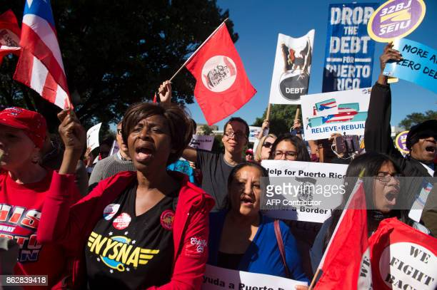 Demonstrators with Progressive Cities hold a protest to demand more recovery assistance for areas hit by recent hurricanes including Puerto Rico from...