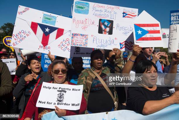 Demonstrators hold a protest to demand more recovery assistance for areas hit by recent hurricanes including Puerto Rico from Hurricane Maria during...