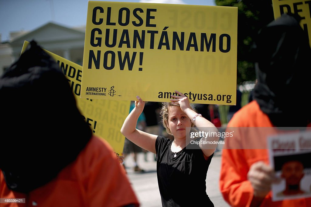 Demonstrators hold a rally to urge President Barack Obama to fulfill his pledge to close the military prison at Guantanamo Bay, Cuba, and end indefinite detention outside the White House May 23, 2014 in Washington, DC. Organized by several groups, including The National Religious Campaign Against Torture, CODEPINK, Amnesty International, the Torture Abolition and Survivor Support Coalition and the Dorothy Day Catholic Worker, the protesters gathered to mark the anniversary of Obama's May 23, 2013 national security speech.