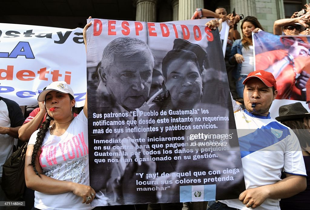 Demonstrators hold a sign 'dismissing' Guatemalan President <a gi-track='captionPersonalityLinkClicked' href=/galleries/search?phrase=Otto+Perez+Molina&family=editorial&specificpeople=800118 ng-click='$event.stopPropagation()'>Otto Perez Molina</a> and Vice President Roxana Baldetti during a protest against the recent corruption cases in the government, in Guatemala City on April 25, 2015. AFP PHOTO / JOHAN ORDONEZ