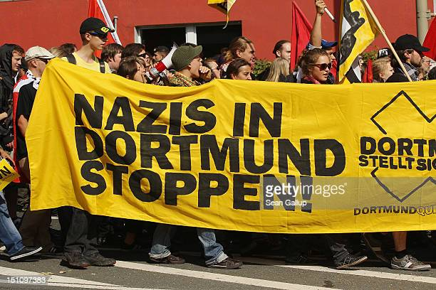 Demonstrators hold a sign that reads 'Stop Nazis in Dortmund' while marching to celebrate a court order banning a march by neoNazis on September 1...