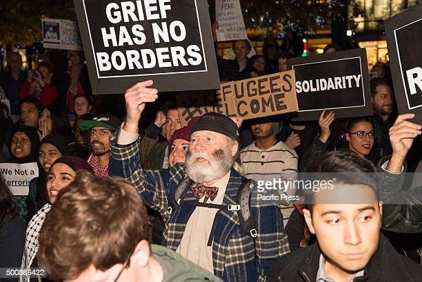Demonstrators hold aloft signs at the rally against Donald Trump's proposed ban on asylum for Muslim immigrants On International Human Rights Day...