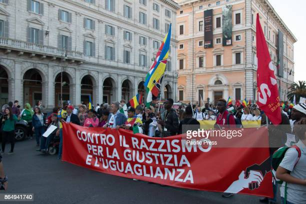 Demonstrators hold an antiracism protest in the streets of Rome