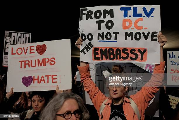 Demonstrators hold banners and shout slogans during the protest in support of 'Women's March' parade against President Donald Trump at Washington...