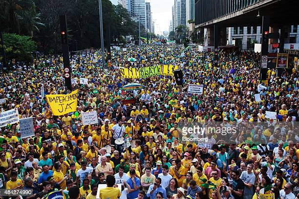 Demonstrators hold banners and signs during a protest in Sao Paulo Brazil on Sunday Aug 16 2015 Nationwide street protests Sunday against Brazilian...
