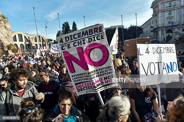 Demonstrators hold banners during a demonstration of the 'C'e chi dice no' movement calling for a 'no' vote to the upcoming referendum on...