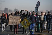 Demonstrators hold banners during a protest prior to municipal elections in Meyerton town of Guaeteng South Africa on July 22 2016