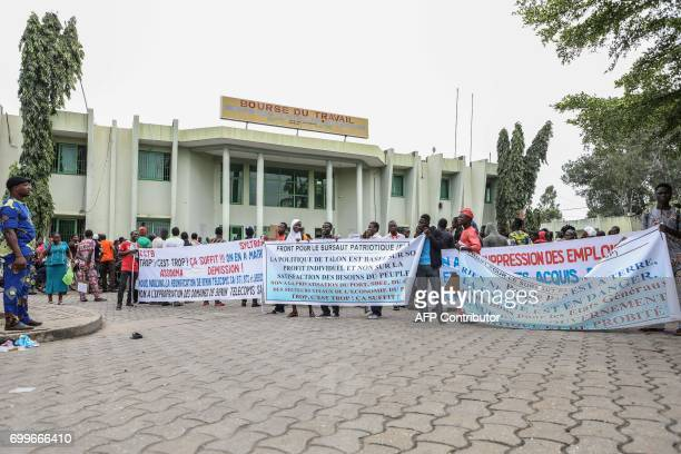 Demonstrators hold banners reading 'The country is in danger' and 'Benin's president Patrice Talon seeks personal profit and not the satisfaction of...