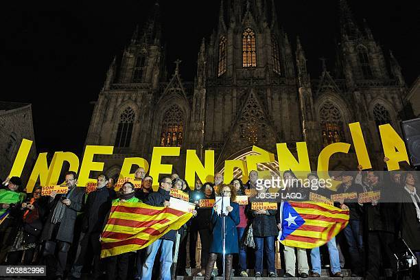 Demonstrators hold big letters forming the word 'Independence' during a demonstration called by the Catalan National Assembly demanding an agreement...