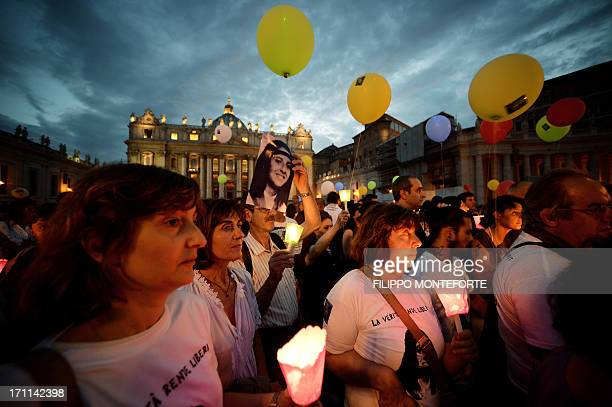 Demonstrators hold candles during a commemoration of the 30th anniversary of Emanuela Orlandi disappearance in St Peter's Square at the Vatican on...