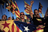 Demonstrators hold Catalan independentist flags during a protest as part of a campaign for independence from Spain at the Pedralbes Palace in...