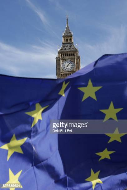 Demonstrators hold EU flags as they enter Parliament Square and pass the Houses of Parliament during an antiBrexit proEuropean Union march in central...