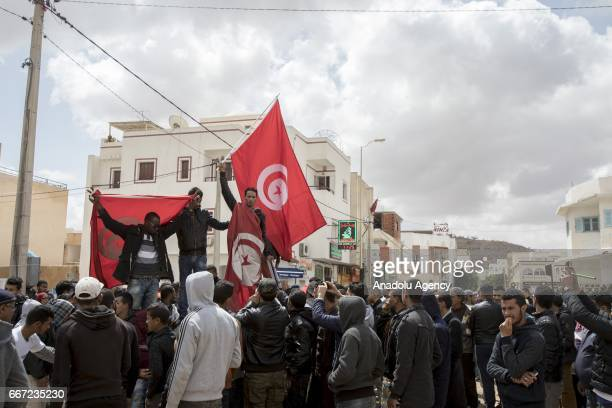 Demonstrators hold flags during a protest against unemployment demanding foreign petroleum companies to employ local residents in the area in...