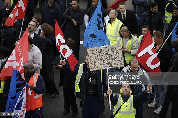 Demonstrators hold FO union flags and placard reading 'I am Charlie' during a demonstration in front of the Air France headquarters in RoissyenFrance...
