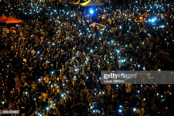 Demonstrators hold high lit cellphones to form a 'sea of lights' in Admirality as part of a prodemocracy sitin known as 'Occupy Central' blocking...