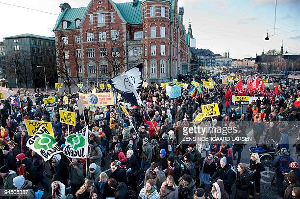 Demonstrators hold march during a rally outside the United Nations Climate Change Conference 2009 in Copenhagen on December 12 2009 Some 300 youths...