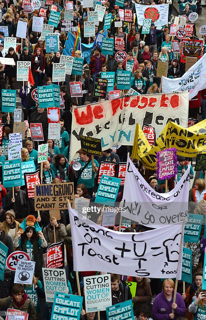Demonstrators hold placards and banners as they gather before the start of a student rally in central London on November 21, 2012 against sharp rises in university tuition fees, funding cuts and high youth unemployment.