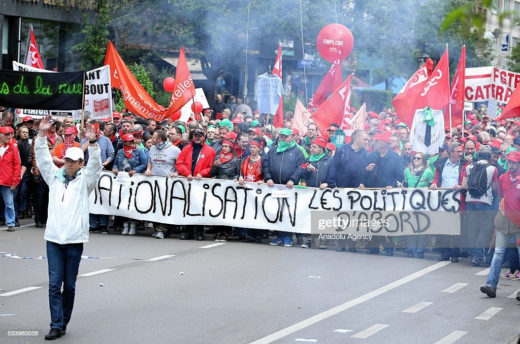Demonstrators hold placards and banners as they gather for a national protest on May 24, 2016, in Brussels, Belgium. Belgian trade unions called for mass protests against the centre-right government's proposed work reforms.