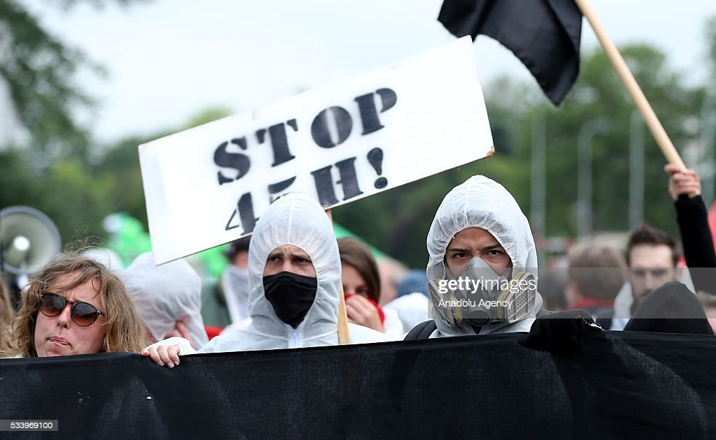 Demonstrators hold placards and banners as they gather for a national protest on May 24, 2016, in Brussels, Belgium. Belgian trade unions called for mass protest against the center-right government's social and economic policies.