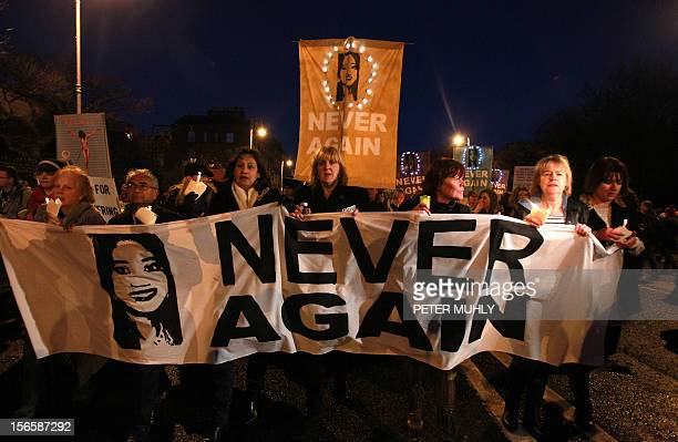 Demonstrators hold placards and candels in memory of Indian Savita Halappanavar in support of legislative change on abortion during a march from the...