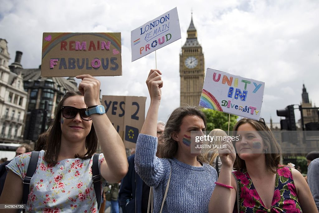 Demonstrators hold placards duringa protest against the pro-Brexit outcome of the UK's June 23 referendum on the European Union (EU), in central London on June 25, 2016. The result of Britain's June 23 referendum vote to leave the European Union (EU) has pitted parents against children, cities against rural areas, north against south and university graduates against those with fewer qualifications. London, Scotland and Northern Ireland voted to remain in the EU but Wales and large swathes of England, particularly former industrial hubs in the north with many disaffected workers, backed a Brexit. / AFP / JUSTIN