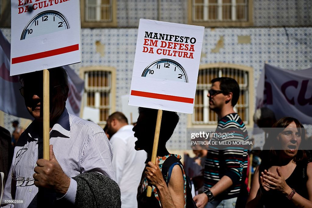 Demonstrators hold placards reading 'In defense of the culture' during the traditional May Day rally in Lisbon on May 1, 2016. Thousands of people demonstrated today in Lisbon and Portugal's main cities against the government's austerity measures. / AFP / PATRICIA