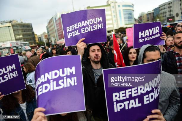 Demonstrators hold placards reading 'Referendum should be cancelled' during a protest at the Kadikoy district in Istanbul on April 23 2017 following...