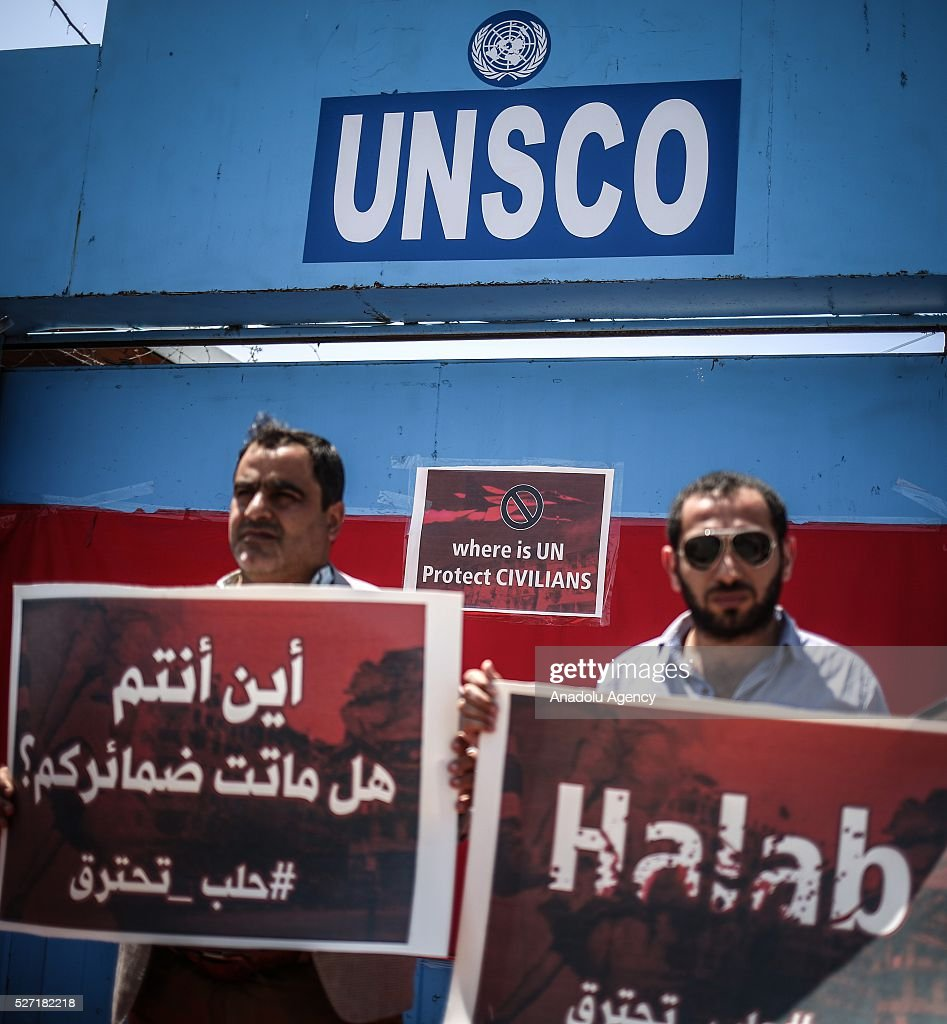 Demonstrators hold placards saying 'Aleppo is burning, do not kill children' during a protest against attacks of Assad regime and Russia to Aleppo, on May 2, 2016 in front of UNSCO office in Gaza City, Gaza.