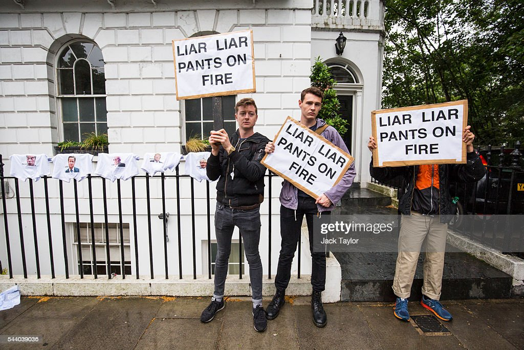 Demonstrators hold placards with the words 'Liar Liar Pants On Fire' written on them as they protest next to underwear, featuring various politicians faces, hung up outside the home of former London Mayor Boris Johnson on July 1, 2016 in London, England. Mr Johnson backed out of the Conservative Leadership contest yesterday after his ally and supporter Justice Secretary Michael Gove announced he too would run. Home Secretary Theresa May is now leading the race to head the Conservative Party that could lead to becoming Prime Minister.