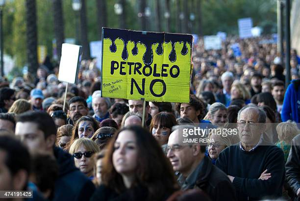 Demonstrators hold posters during a demonstration in Palma de Mallorca on February 22 2014 against oil exploration off the coast near the Balearic...