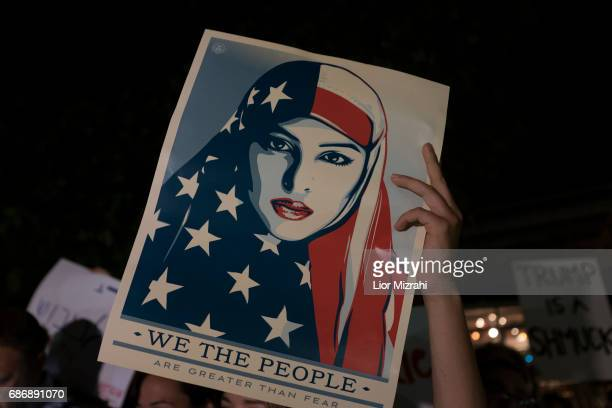 Demonstrators hold posters during a protest against US President Donald Trump next to the American consulate on May 22 2017 in Jerusalem Israel Trump...
