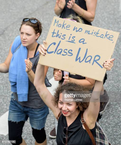 Demonstrators hold signs as they gather for 'Grenzenlose Solidaritaet statt G20' during a protesters march against the G20 Summit on July 8 2017 in...