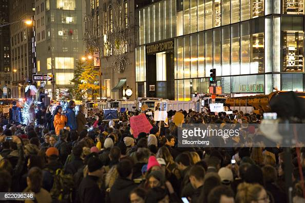 Demonstrators hold signs as they gather outside Trump Tower during a rally against US Presidentelect Donald Trump in New York US on Wednesday Nov 9...