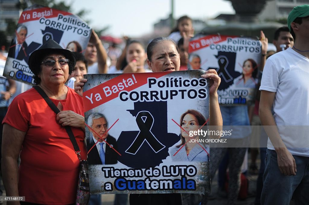 Demonstrators hold signs during a protest against Guatemalan President <a gi-track='captionPersonalityLinkClicked' href=/galleries/search?phrase=Otto+Perez+Molina&family=editorial&specificpeople=800118 ng-click='$event.stopPropagation()'>Otto Perez Molina</a> and Vice President Roxana Baldetti for the recent corruption cases in the government, in Guatemala City on April 25, 2015. AFP PHOTO / JOHAN ORDONEZ