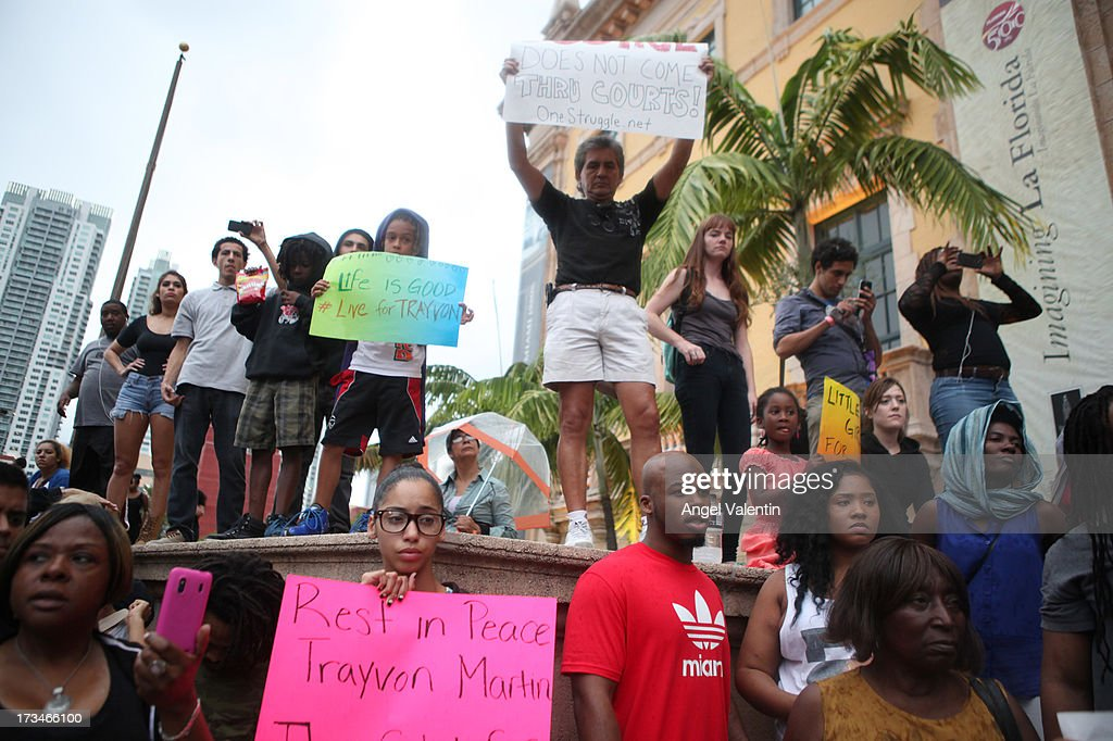 Demonstrators hold signs in front of the Freedom Tower in downtown Miami a day after the verdict to the George Zimmerman murder trail on July 14, 2013 in Miami, Florida. A jury found neighborhood watch volunteer, George Zimmerman not guilty of shooting and killing 17-year-old Trayvon Martin after an altercation in February 2012.