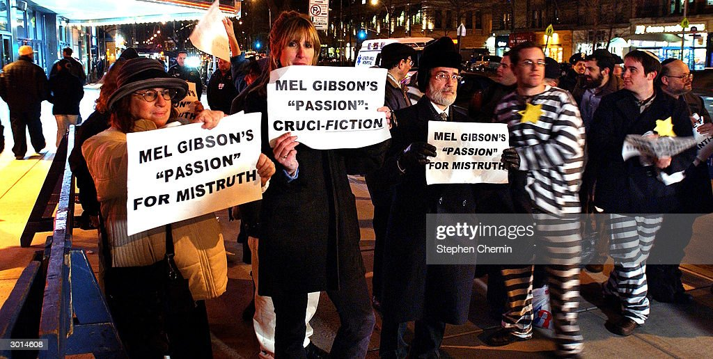 Demonstrators hold signs protesting Mel Gibson's The Passion of the Christ outside a movie theater February 25, 2004 in New York CIty.'The Passion of the Christ' opened in cinemas across the country as many Jewish groups pinned it as anti-Semitic.