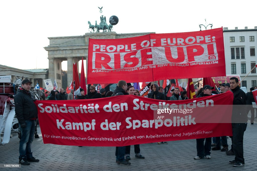 Demonstrators hold up a banner during an anti-austerity protest on November 14, 2012 in front of the Brandenburg Gate in Berlin. The head of Germany's Federation of Trade Unions warned against the effects of austerity cuts in crisis-wracked southern European countries Wednesday and voiced solidarity with Europe-wide rallies and strikes.