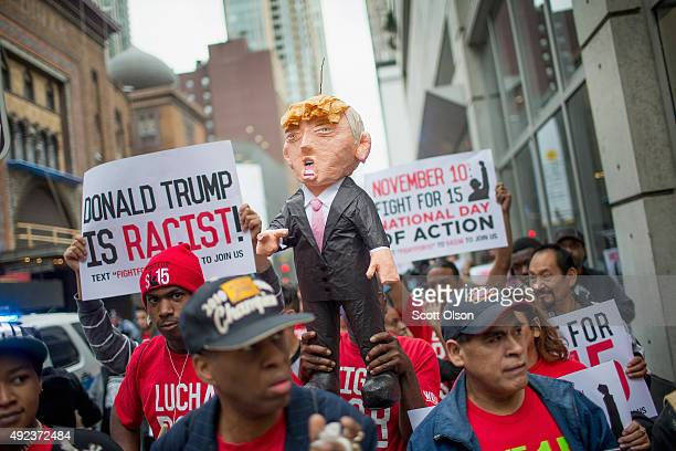Demonstrators hold up a piñata of Republican Presidential candidate Donald Trump during a protest on October 12 2015 in Chicago Illinois About 250...