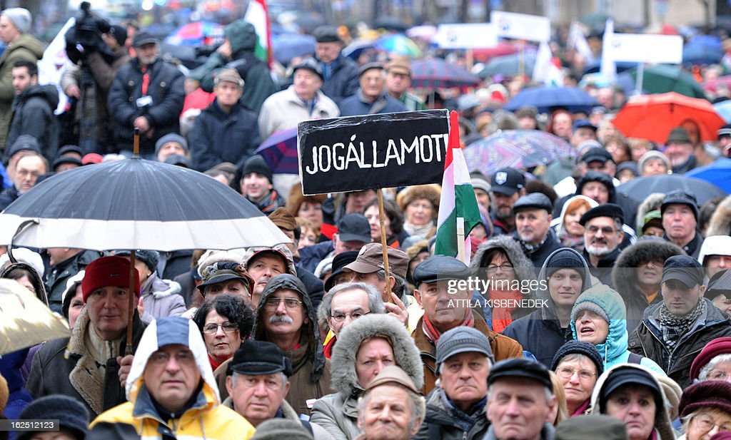 Demonstrators hold up a placard written 'be constitutional state' as employers of Hungary's opposition radio, the 'Klubradio' and their sympathizers attend a demonstration for the freedom of speech in Budapest on February 24, 2013. Hungarian court is ruling on March 5, on opposition Klubradio's fight against authorities for a new frequency.