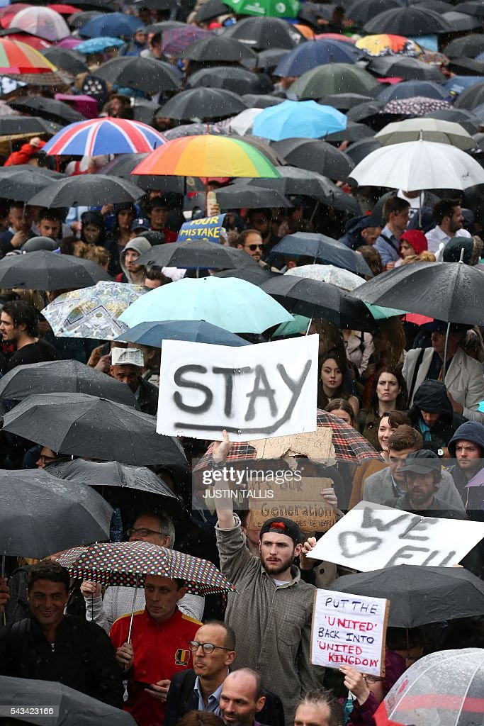 Demonstrators hold up Pro-Europe placards at an anti-Brexit protest in Trafalgar Square in central London on June 28, 2016. EU leaders attempted to rescue the European project and Prime Minister David Cameron sought to calm fears over Britain's vote to leave the bloc as ratings agencies downgraded the country. Britain has been pitched into uncertainty by the June 23 referendum result, with Cameron announcing his resignation, the economy facing a string of shocks and Scotland making a fresh threat to break away. / AFP / JUSTIN
